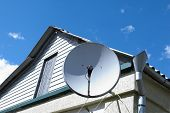 stock photo of wall cloud  - satellite dish on the wall clouds in the sky solar time - JPG