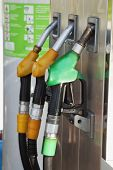 foto of fuel economy  - Fuel pump with three pumps vertical image