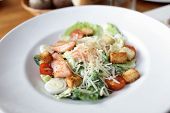 picture of caesar salad  - Caesar Salad with salmon cherry tomatoes in a bowl - JPG