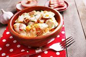 pic of fried onion  - Fried dumplings with onion and bacon in frying pan - JPG