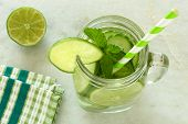 image of mason  - Detox water with lime and cucumbers in a mason jar with straw - JPG