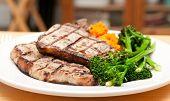 image of pork chop  - farm raised heritage pork sirloin chops with fresh vegetabes - JPG