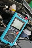 foto of motor vehicles  - Car diagnostic tool against the background of the motor vehicle - JPG