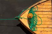stock photo of canoe boat man  - Fisherman boat with ropes and float - JPG