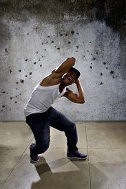 image of gunfights  - young urban black gangster dodging bullets from a drive by shooting - JPG