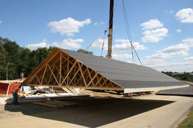 foto of trussle  - moving modular home roof onto road while house is being built and then moved back on top of home - JPG
