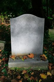 stock photo of life after death  - Weathered blank tombstone in an old cemetery - JPG