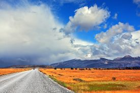 foto of pampa  - On a dirt road on the pampa car rides Strong wind drives the clouds - JPG