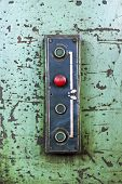 foto of vacuum pump  - Red stop button on an old machine - JPG