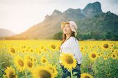 Happy Woman In Sunflower Field Smiling With Happiness poster