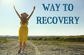 Rehabilitation concept. Woman walking on road. Text WAY TO RECOVERY on landscape background poster
