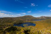 High angle view of Lake Lilla and Dove Lake surrounded by green mountains at Cradle mountain, Lake S poster