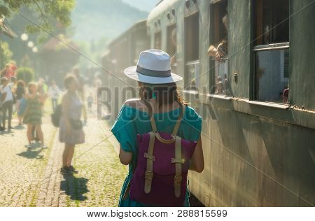 poster of Traveler Girl On Train Station In Vacation. Young Traveler Girl In Vacation. Girl Traveling By Train