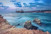 Rocks In Sea With Abandoned Ship On Background Near Paphos, Cyprus  (with Hdr-effect) poster
