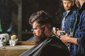 Barber With Clipper Styling Hair Of Brutal Bearded Client. Hipster Lifestyle Concept. Barber With Ha poster