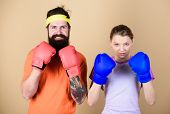 Ready To Fight. Man And Woman In Boxing Gloves. Boxing Sport Concept. Couple Girl And Hipster Practi poster