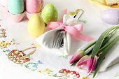 Easter place setting on an elegant linen table cloth.  This traditional holiday brunch place setting poster