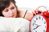 stock photo of underthings  - Portrait of young woman with alarm clock - JPG