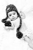 Cute 3-Months Baby wearing a pom-pom knit hat