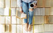 A Young Woman Reads A Book And Drinks Coffee. A Lot Of Books. Concept For World Book Day, Lifestyle, poster