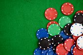 Poker Chips On Green Background