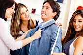 stock photo of tailoring  - Man at the tailor buying a custom made suit - JPG