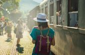 Traveler Girl On Train Station In Vacation. Young Traveler Girl In Vacation. Girl Traveling By Train poster