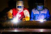 Welder-worker Welding And Cutting Steel In Workshop Of Construction Site With Oxy-propane Cutting An poster