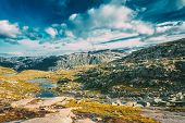 Landscape Of Norwegian Mountains. Nature Of Norway. Travel And Hiking. Amazing Scenic View At Sunny  poster