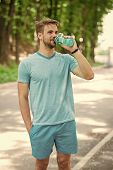 Long Workout Is Over. Man With Athletic Appearance Holds Bottle With Water. Athlete Drink Water Afte poster