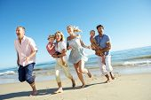 stock photo of multi-generation  - Multi Generation Family Enjoying Beach Holiday - JPG