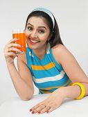 Beautiful Young Asain Woman Drinking Orange Juice