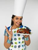 Female Chef From Asia With Her Roasted Chicken poster
