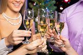 foto of congrats  - Image of people hands with crystal glasses full of champagne - JPG