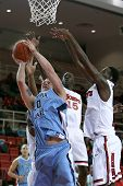 NEW YORK-NOV 3: Sonoma State Seawolves forward Brandon Glanz shoots a basket under St. John's Red St