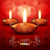 picture of diya  - beautiful shiny diwali diya placed on artistic red background - JPG