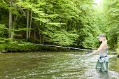 pic of fisherwomen  - woman fishing in river - JPG