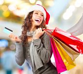 Christmas Shopping. Beautiful Happy Girl With Credit Card In Shopping Mall. Shopping Bags. Shopping