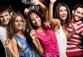 stock photo of club party  - Portrait of glad teens looking at camera with smiles during party - JPG