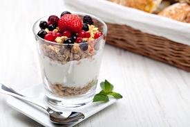 stock photo of cobnuts  - yogurt with muesli and berries in small glass - JPG