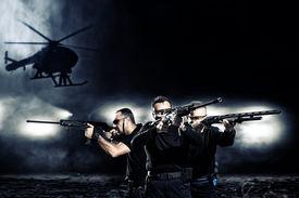 stock photo of gunshot  - special  tactics team - JPG