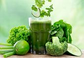 stock photo of vegetables  - Healthy green vegetable juice on wooden table - JPG