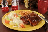 picture of baby back ribs  - Barbecued baby back ribs with baked beans and salad - JPG