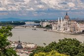picture of hungarian  - The building of the Hungarian Parliament in Budapest at the river Danube Hungary - JPG