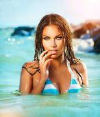 foto of bathing  - Beauty Sexy Model Girl Swimming and Posing in the Sea - JPG