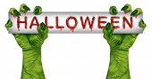 stock photo of zombie  - Halloween zombie sign with green monster hands dripping in blood holding a sign card as a creepy or scary symbol with wrinkled creature fingers and stitches isolated on a white background - JPG