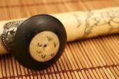 stock photo of opium  - An ivory opium pipe on a bamboo mat - JPG