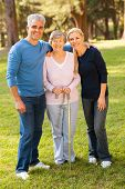 picture of mother law  - portrait of middle aged couple and mother outdoors - JPG