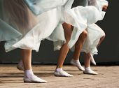 stock photo of stocking-foot  - feet dancing women on the stage outdoor - JPG