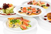 stock photo of cooked crab  - Small portions of food on big white plates close up - JPG